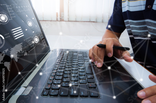 Fototapety, obrazy: Man working with digital tablet, laptop and smart phone at his office.