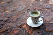 Cup of hot milk green tea, beverage for relax time put on wood table from side view