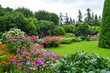 Summer garden in Saint Petersburg city, landscape. Beautiful park, flowers and trees view, green lawn, grass. Famous historical place. For posters, interior decoration, calendars, prints designs.