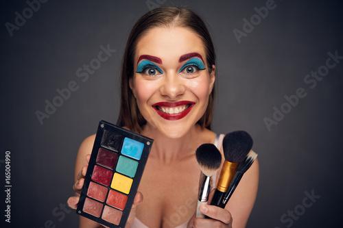 Fotografía  Crazy make up artist with clown worst make up.