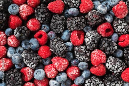 Assorted frozen berries background, top view