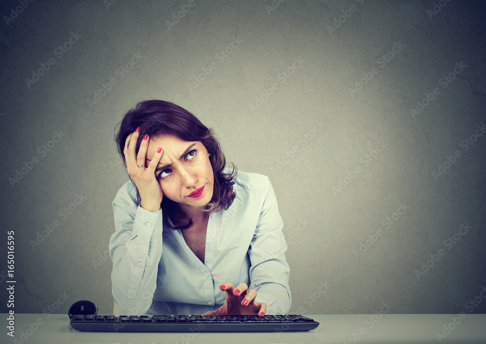 Fototapeta Desperate woman trying to log into her computer forgot password