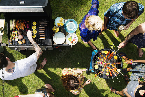 Stickers pour portes Grill, Barbecue Aerial view of diverse friends grilling barbecue outdoors