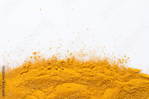 Valokuvatapetti Turmeric powder isolated on white background