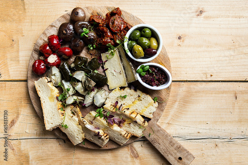 meat and cheese charcuterie on wooden platter Poster