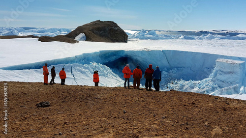 Tuinposter Antarctica Antarctica March 23, 2016:People, scientists, researchers are on the mountain of stone. Near the shore of the ocean and icebergs. Antarctic.