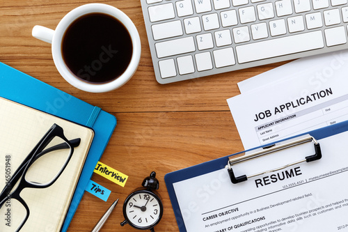 Fotografia  Job search with wood desk background