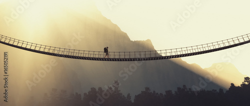 Fotografía  Man with backpack on a rope bridge