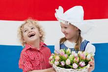 Dutch Kids With Tulip Flowers ...