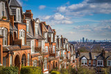Fototapeta Londyn - London, England - Typical brick houses and flats and panoramic view of london on a nice summer morning with blue sky and clouds taken from Muswell Hill
