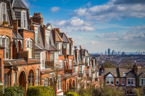 Poster Londres London, England - Typical brick houses and flats and panoramic view of london on a nice summer morning with blue sky and clouds taken from Muswell Hill