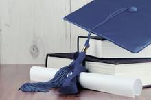 A Blue Graduation Cap Resting ...