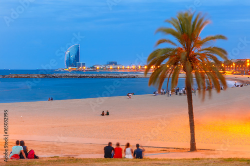 Foto auf Gartenposter Barcelona Barceloneta Beach in Barcelona during morning blue hour, Catalonia, Spain.