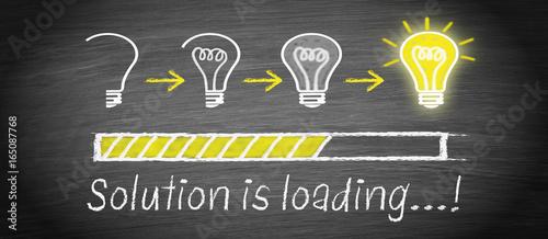 Photo  Solution is loading - big idea and creativity light bulb concept