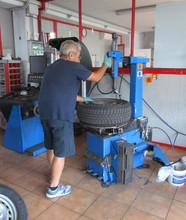 The Tire Repairer Extracts The...