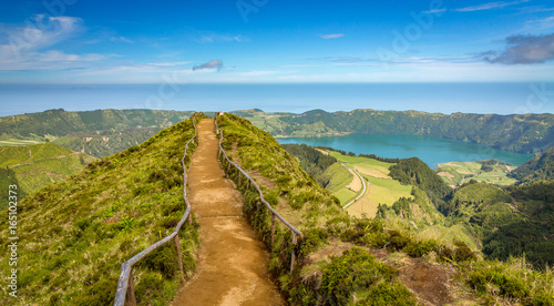 Fotobehang Bergen Walking path to a view on the lakes of Sete Cidades, Azores, Portugal