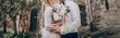 canvas print picture - stylish wedding couple with bouquet. modern bride and groom holding fashionable bouquet at old  castle. fine art wedding photo, romantic moment, long edge