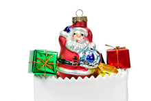 Santa Claus Ornament With Green And Red Christmas Presents In White Ceramic Bag. Isolated.