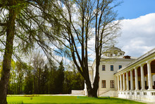 Nice View On Ostafyevo Palace In Moscow Region And Public Park. Antique Mansion 18-19 Century In Classicism Style. Beautiful Landscape With Old Manor, Lawn, Sky And Trees For Wallpapers, Prints.