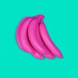 Pink bananas on a turquoise background. Fashionable minimalism. - 165119571