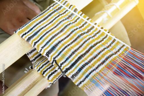Fotografie, Obraz  weave yarn on the manual wood loom  handicraft (Saori) ,thailand,selective focus