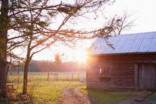 An Old Barn In The Sunset On A Farm With A Path.
