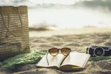 Various Object Lying On The Beach Sand