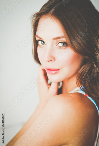 Fototapety, obrazy: Beautiful female in sundress posing on white background.