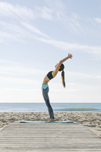 Young Woman Practicing Yoga On...