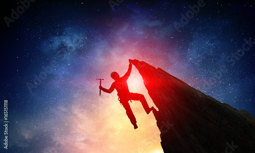 Photo Extreme climbing is his adrenaline . Mixed media