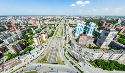 Spoed Foto op Canvas Singapore Aerial city view with crossroads and roads, houses, buildings, parks and parking lots, bridges. Helicopter drone shot. Wide Panoramic image.
