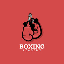 Boxing Logo Concept On Red Background With Hanging Boxing Gloves.