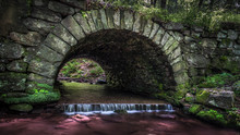 A Stone Culvert With Stream Pa...