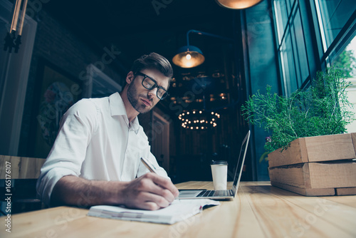 Young stylish well dressed author writer is working in a modern coworking, writi Canvas