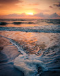 Close up view of sea foam during sunrise on a Florida beach