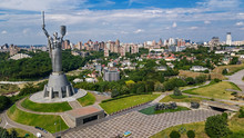 Aerial Top View Of Kiev Motherland Statue Monument On Hills From Above And Cityscape, Kyiv City, Ukraine