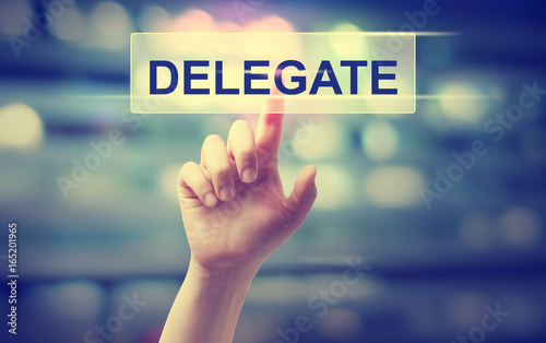 Photo Delegate concept with hand pressing a button