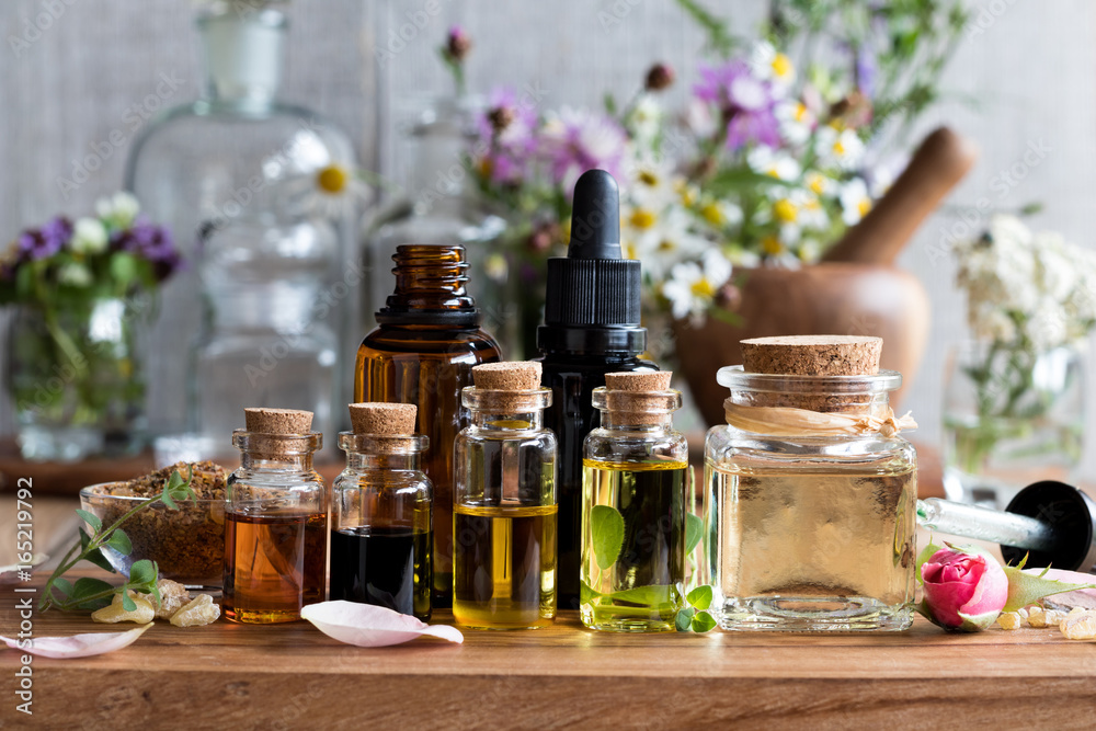 Fototapety, obrazy: Selection of essential oils with herbs and flowers