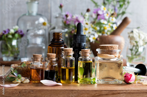 Selection of essential oils with herbs and flowers Canvas-taulu