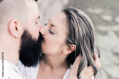 happy lovely couple touching and kissing each other buy this stock