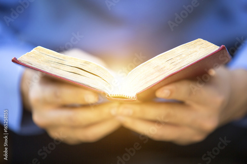 Photo  A man reading the Holy Bible.