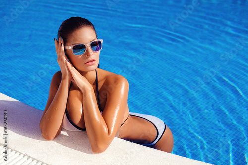 Beautiful girl in outdoor pool