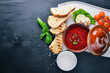 Borsch with sour cream. Ukrainian food. On a wooden background. Top view. Free space for your text.