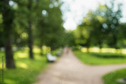 Foto op Aluminium Tuin abstract blurred background of city park in sunny summer day