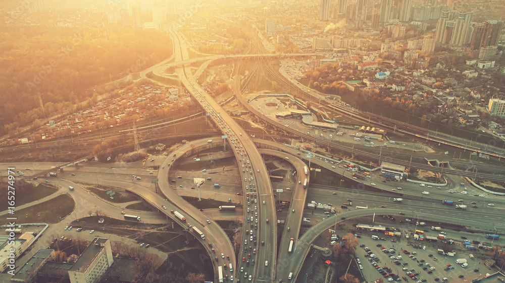 Fototapety, obrazy: Aerial Drone Flight View of freeway busy city rush hour heavy traffic jam highway. Top view. Cityscape in sunset soft light. Instagram vintage filter toning. Kiev, capital of Ukraine