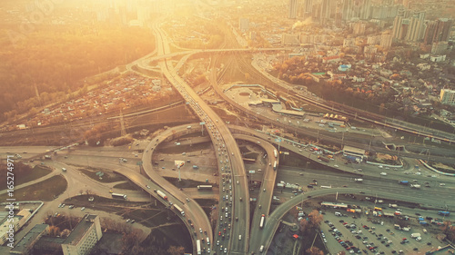 Canvas Print Aerial Drone Flight View of freeway busy city rush hour heavy traffic jam highway