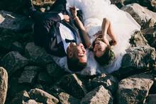 Wedding Couple On The Beach On The Rocks