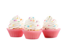 Tasty Cupcakes Isolated On A W...