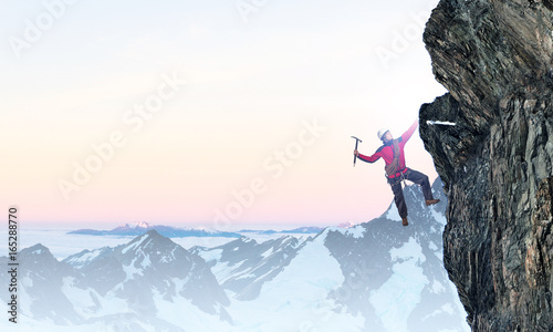 Extreme climbing is his adrenaline . Mixed media Canvas Print