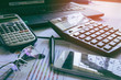 Pen with business graphs and charts report , calculator on desk of financial planing. Financial abstract concepts.